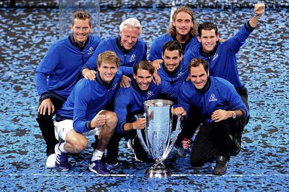 A group of people posing for a photo with a trophy  Description automatically generated with medium confidence