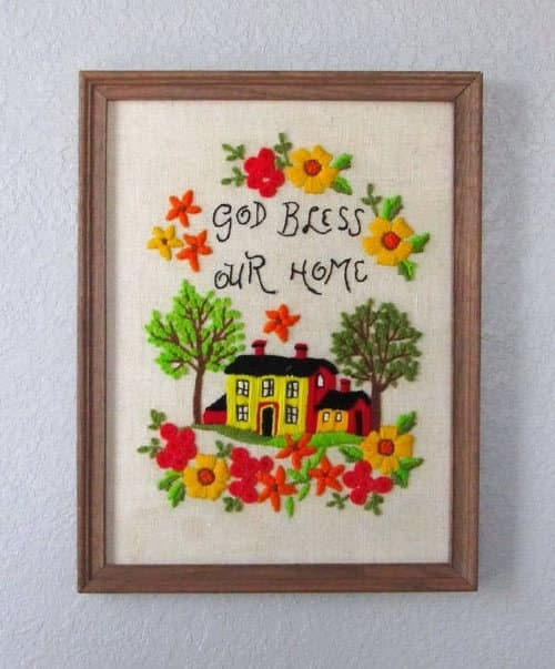 Handmade touches like cross stitching are what makes a house a home. Plus, it's a great way to add texture and color to your walls.