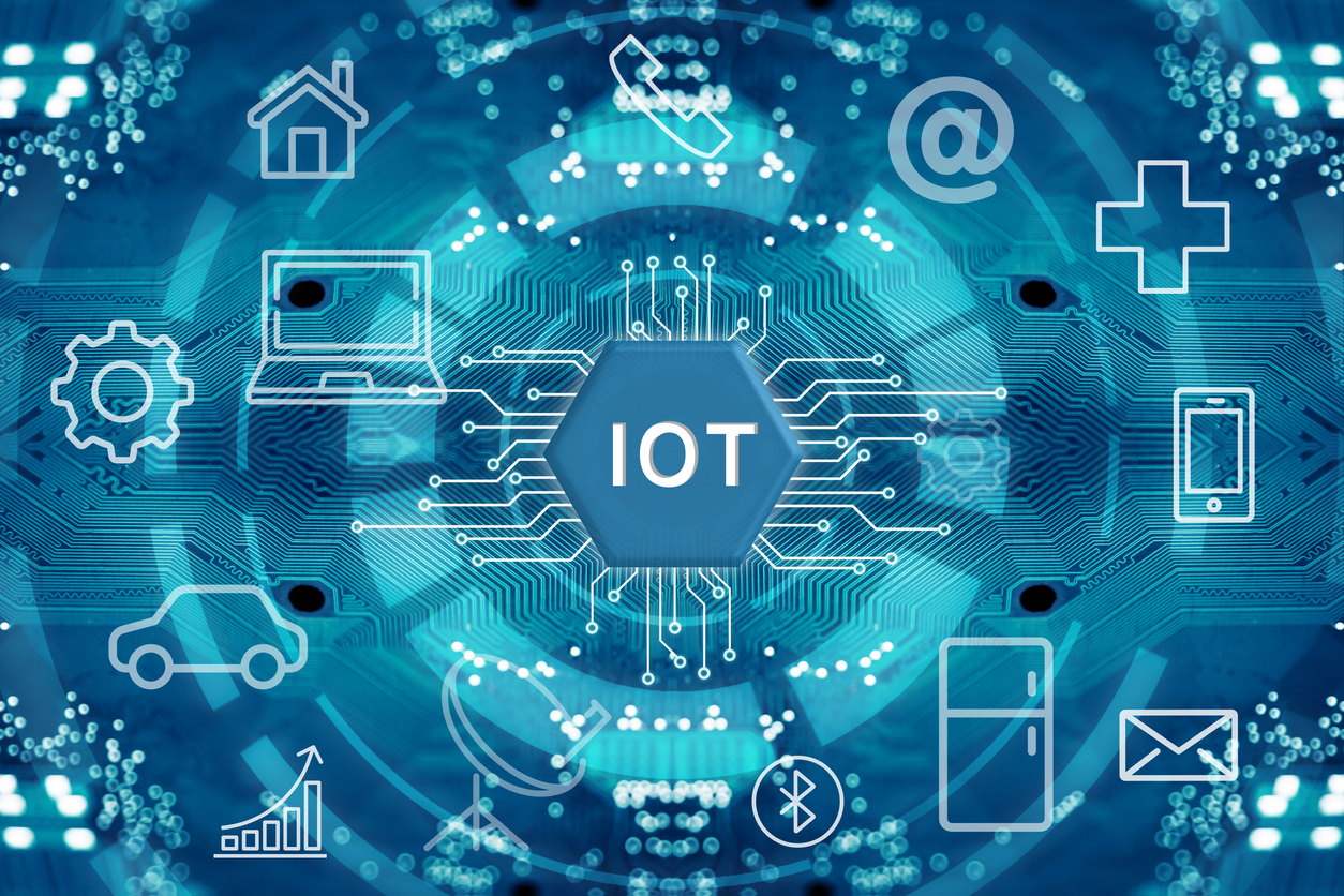 A digital concept for Internet of Things devices, one of our top computer security threats in 2020, with icons for laptop, mobile, home, email, home appliance, Bluetooth, automobile, and more.