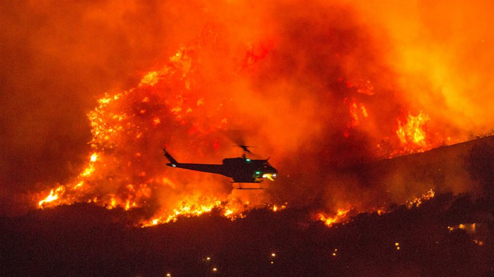 As California burns, the winds arrive and the lights go out - ABC News