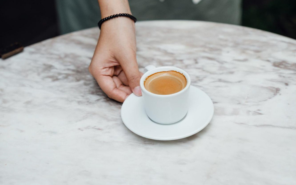 serving a shot of espresso on table