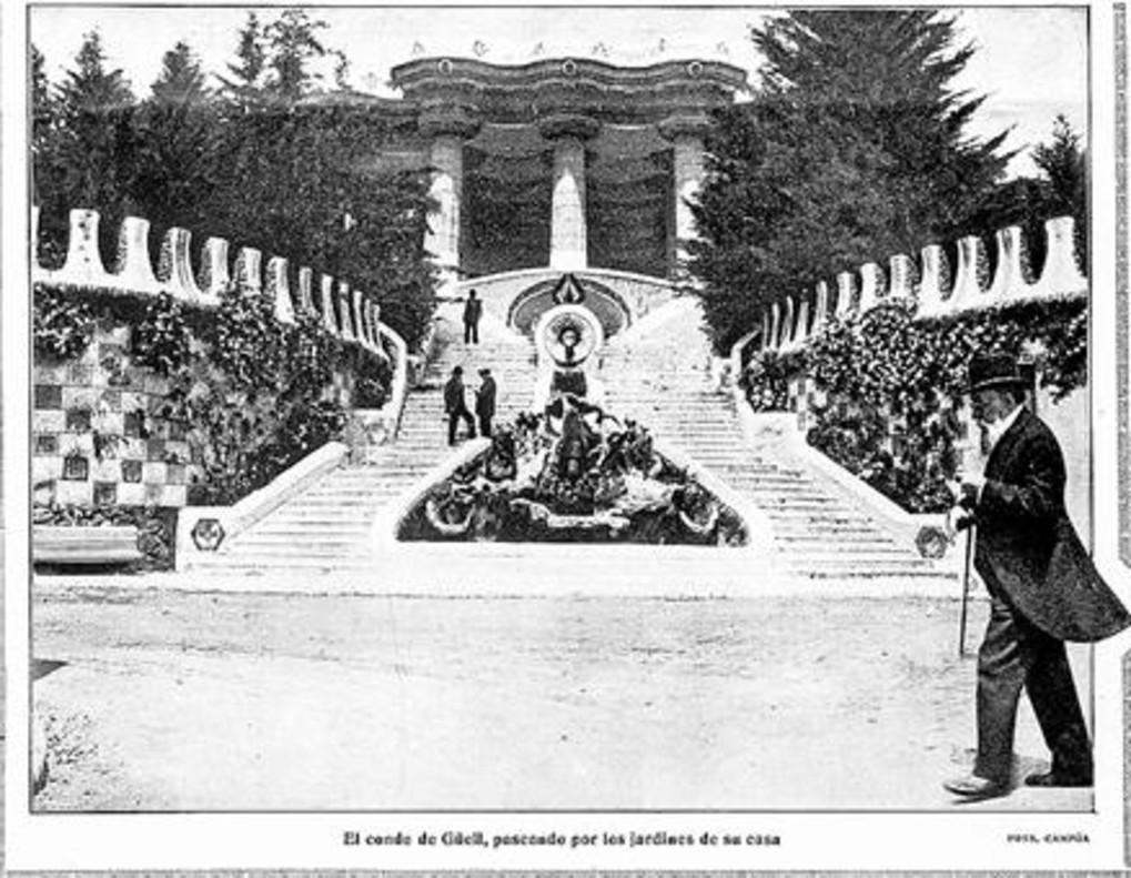 Black and white archive image of  patron, Eusebi Guell visiting Park Guell in front of the Dragon Stairway