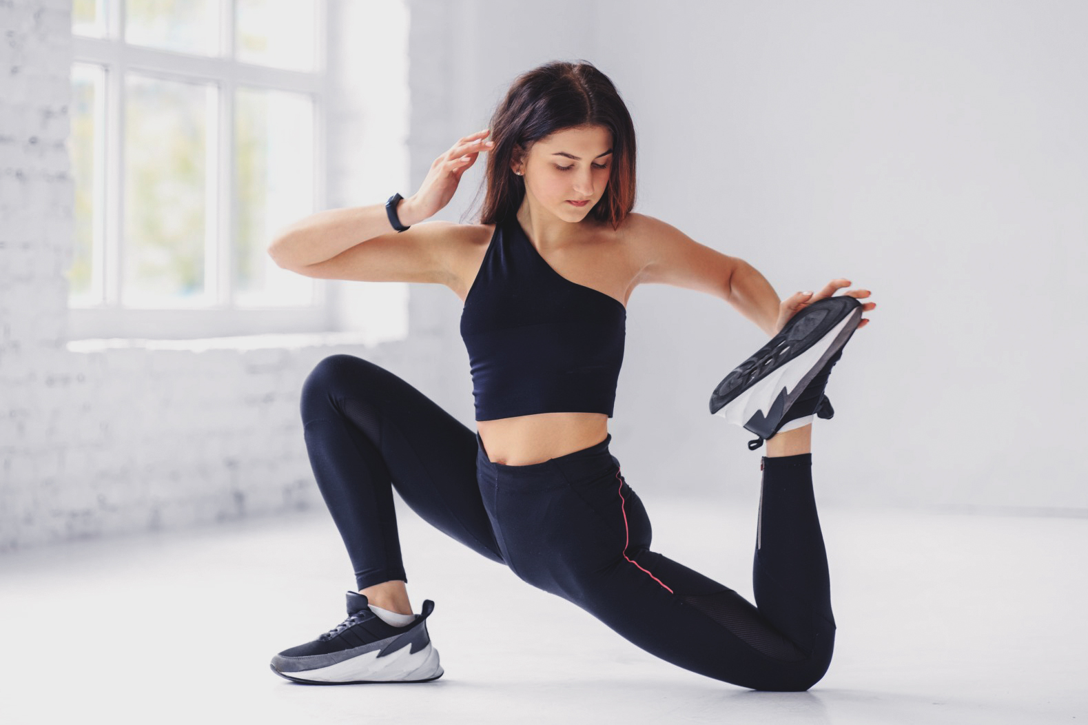 Woman stretching in performance gear