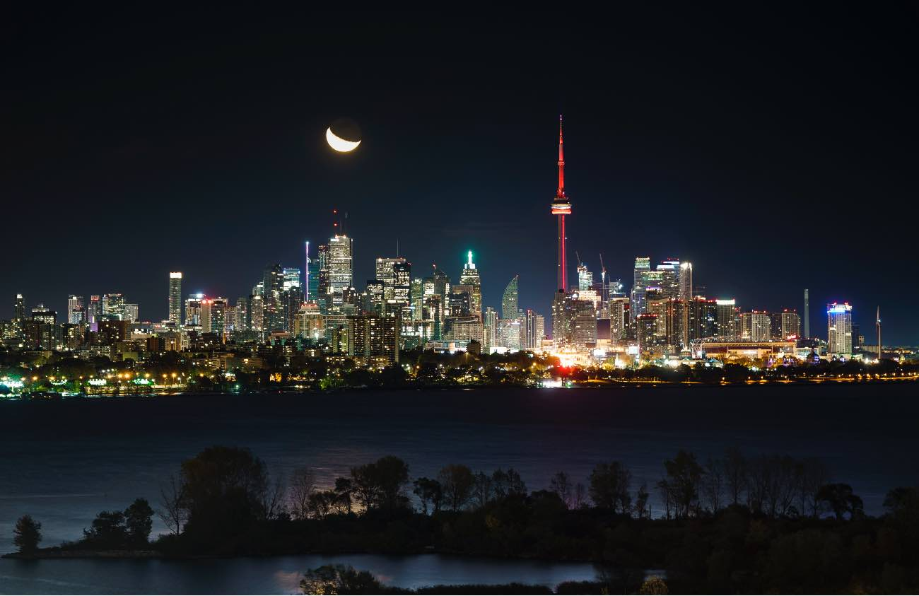 TORONTO, ONTARIO - OCTOBER 23: The moon rises behind the CN Tower and skyline in Toronto on October 23, 2019 in Toronto, Canada. (Photo by Mark Blinch/Getty Images)