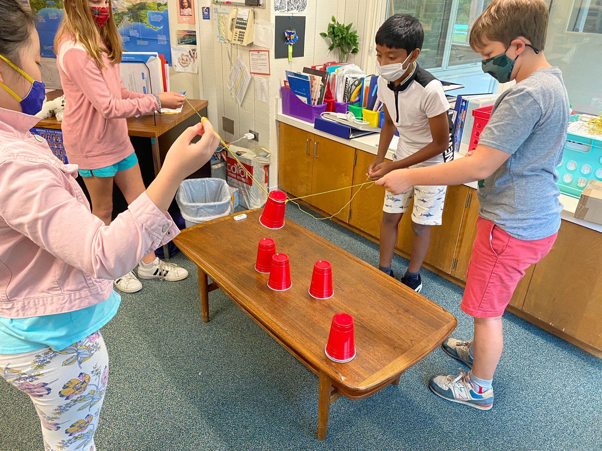 students doing team building with plastic cups