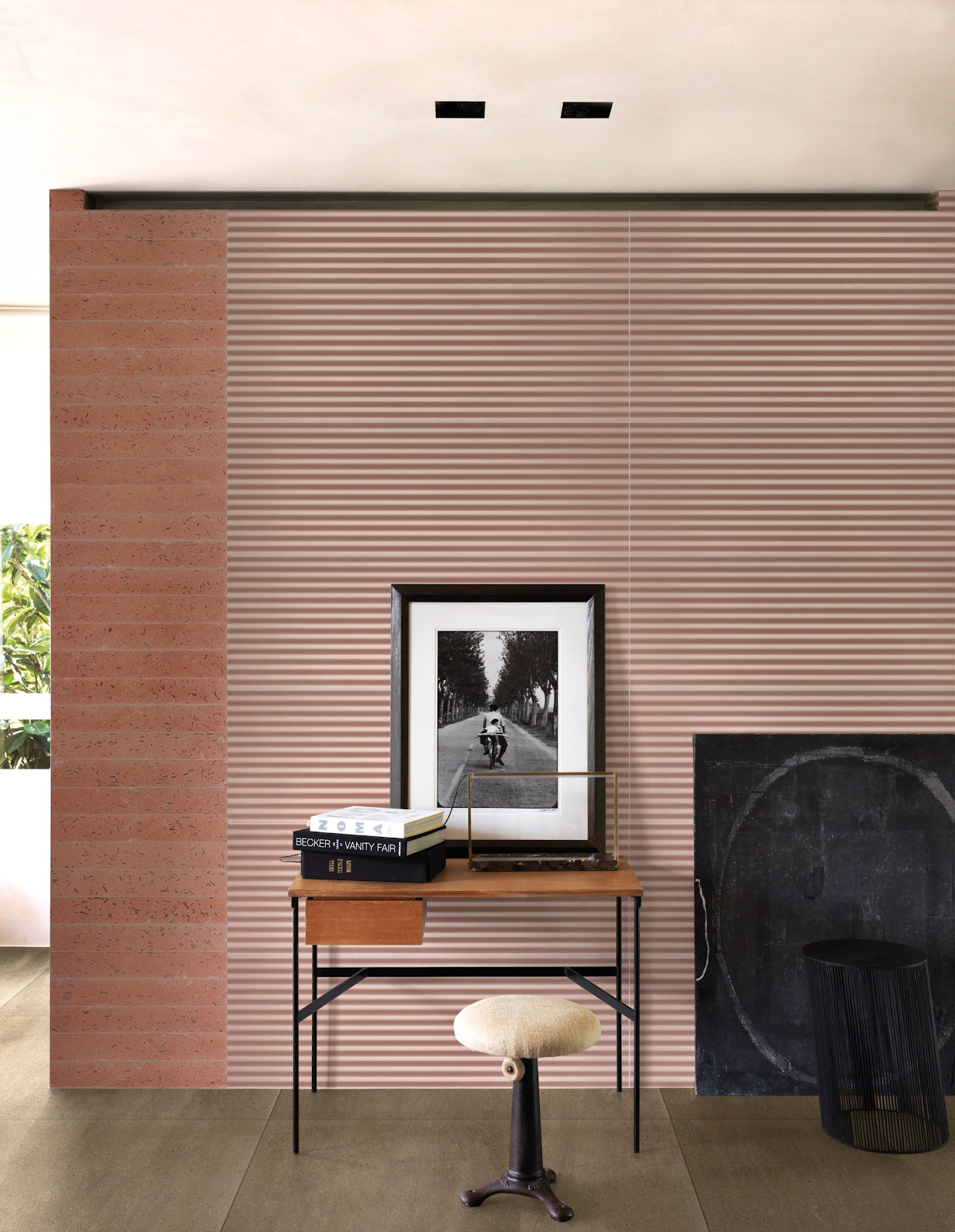 Living room with three-dimensional pastel pink tile wall