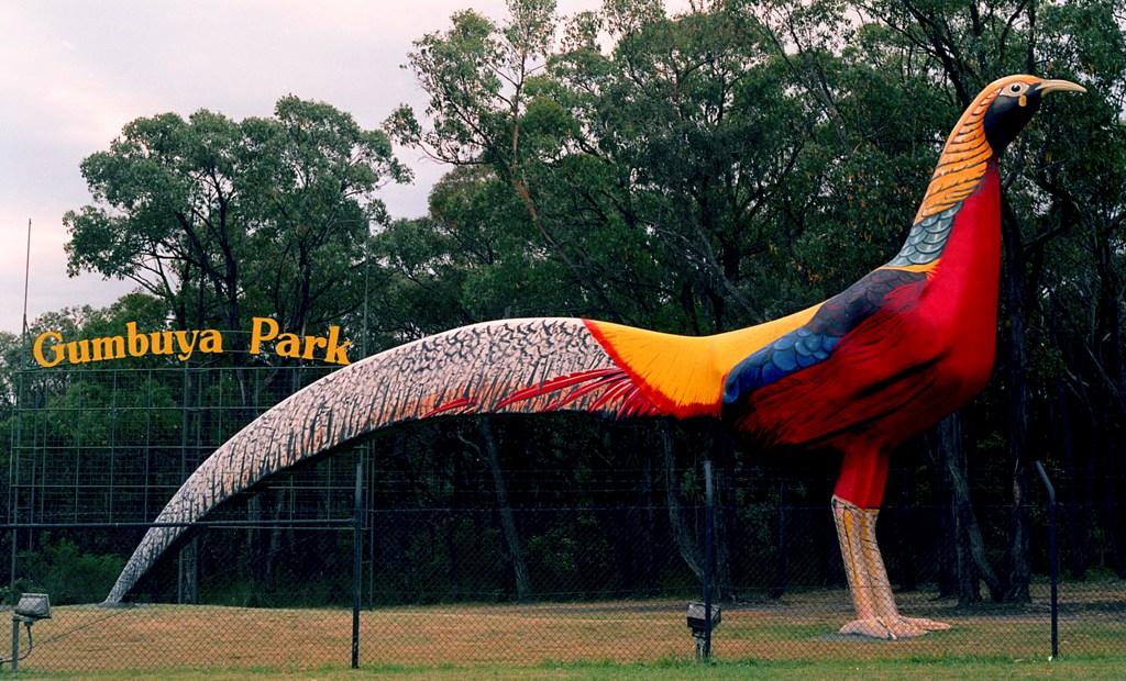 the big pheasant sculpture which is very colourful standing in a park