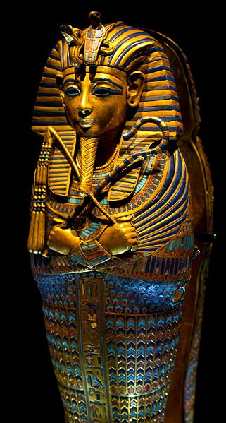 The golden and highly decorated sarcophagus of King Tut.
