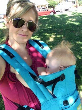 Baby in a structured baby carrier.