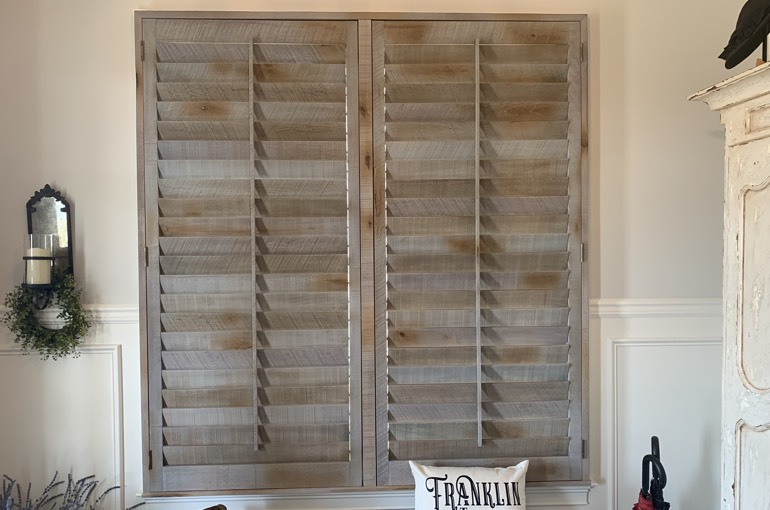 Reclaimed wood shutters above bench