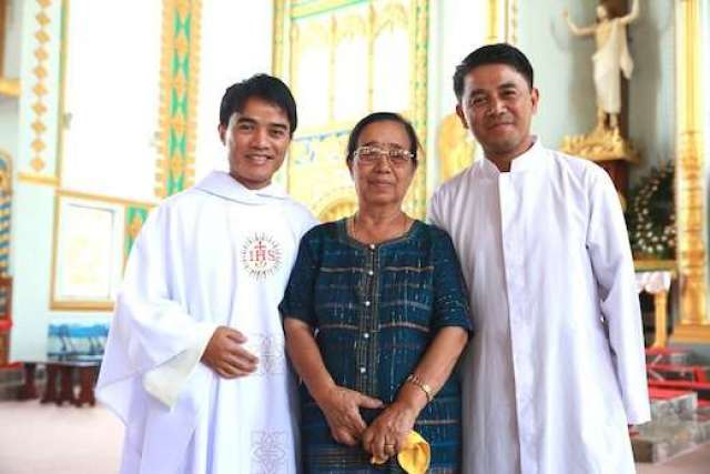 Fr. Wilbert Mireh with his mother and brother, on his ordination day, May 2013.  Credit: Jesuit Asia Pacific Conference