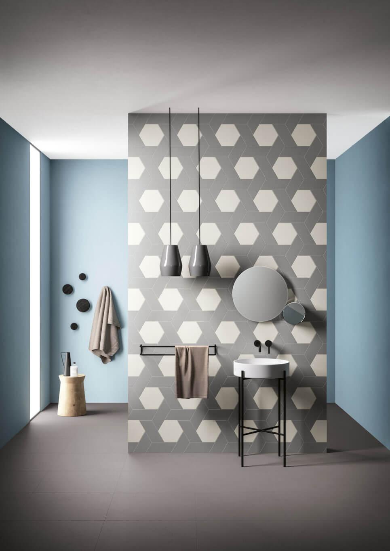 Hexagon tiles interlaced with rhomboid tiles on a bathroom wall