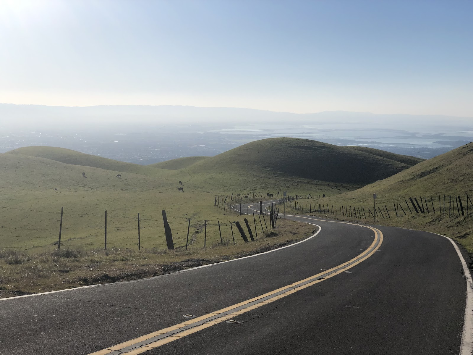 Climbing Sierra Road by bike - view west from the top - roadway and city below
