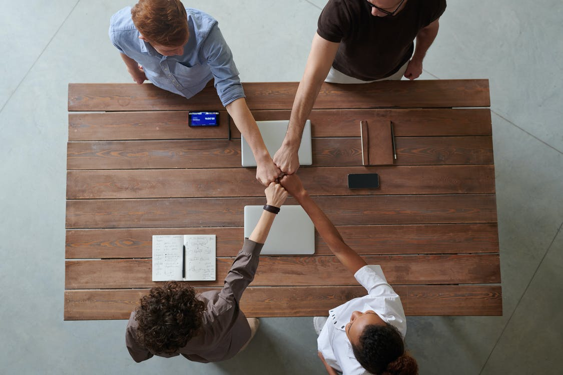 photo-of-people-doing-fist-bump-3184430/improve your brand's reputation
