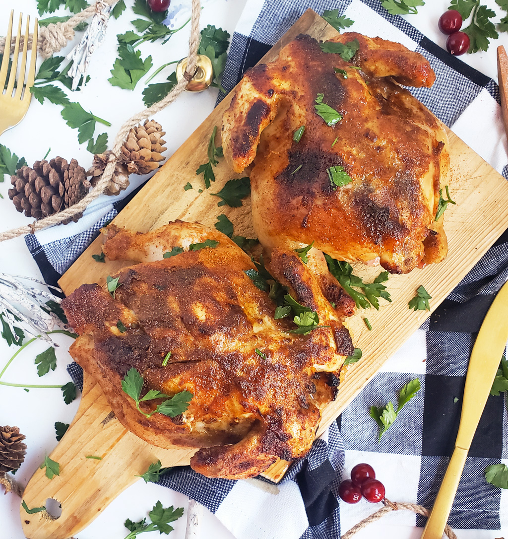 Honey Mustard Cornish Hens with a crispy crust on a wooden board