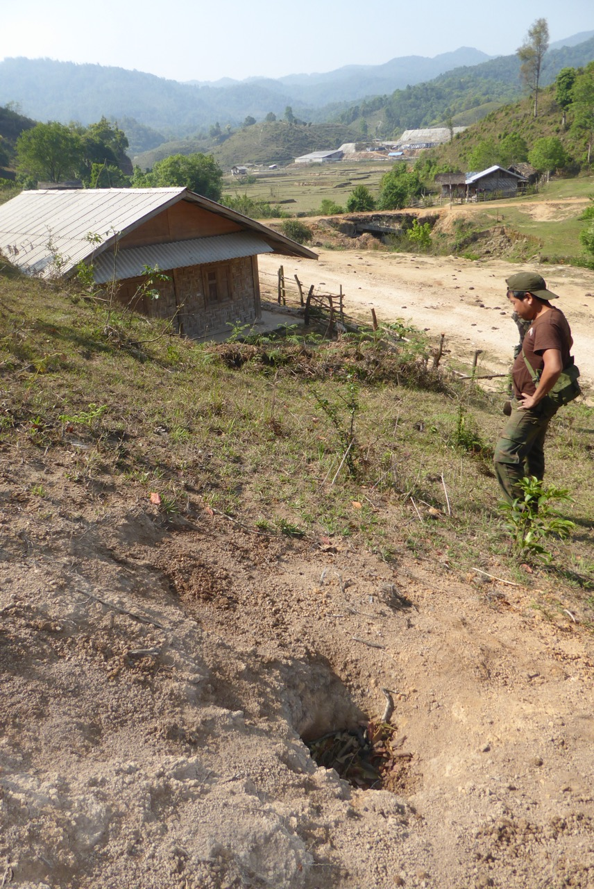 Hole from shell fired by Burma Army at Kachin village near N'Ba Pa