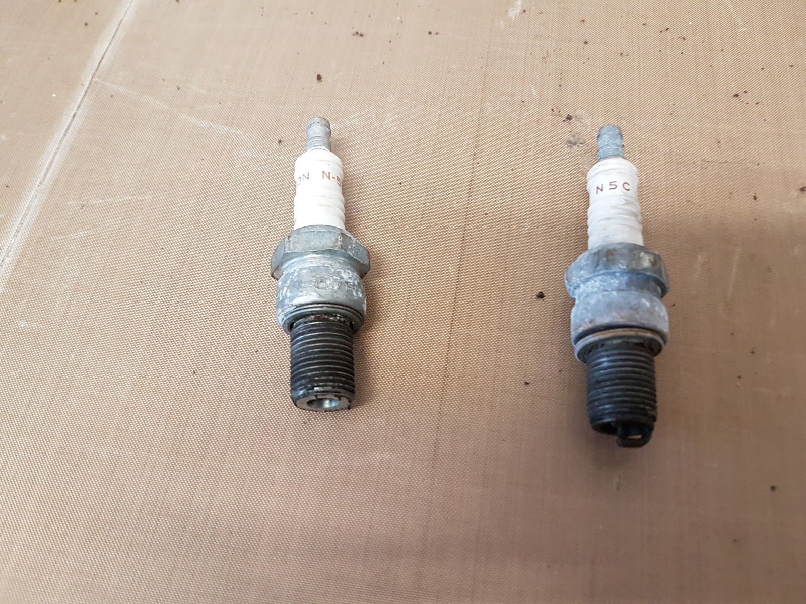 Triumph Boneville T140 mismatched spark plugs extracted.