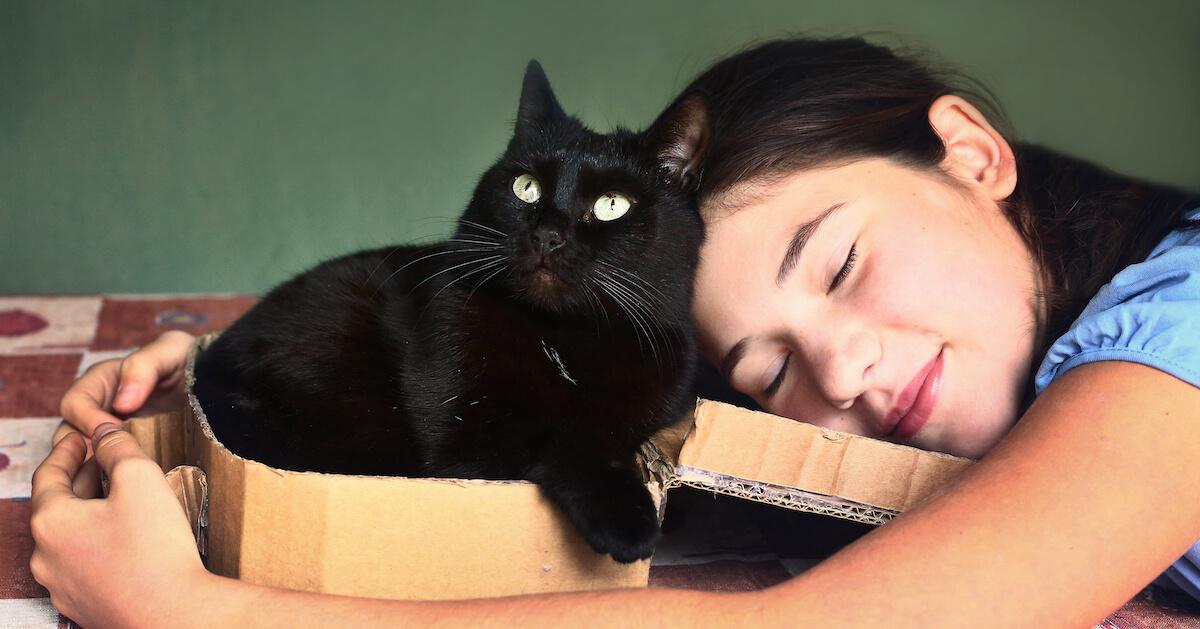 Kid cuddling cat