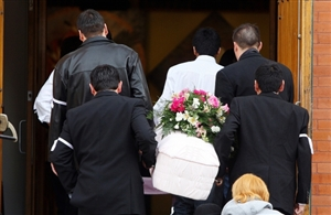 Pallbearers carry the casket of a 21-month-old girl who died in foster care to a funeral mass at Sacred Heart Church of the First Peoples in Edmonton on Tuesday, March 9, 2010.