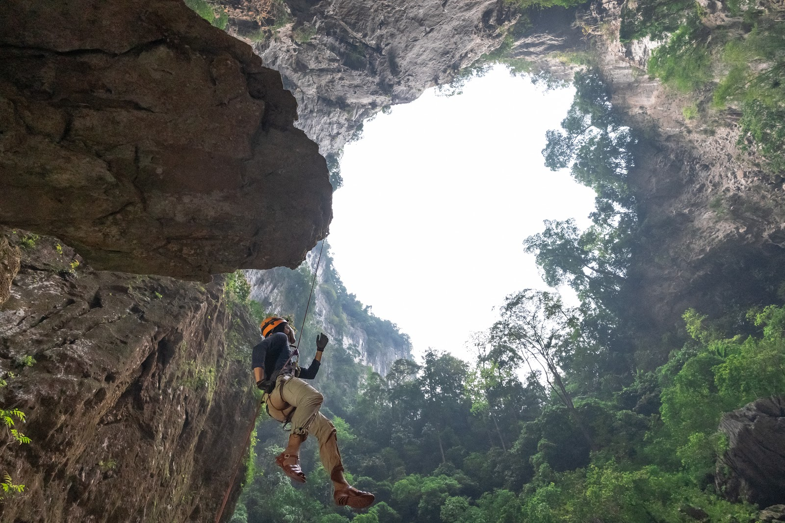 a traveler repelling down at Tiger cave