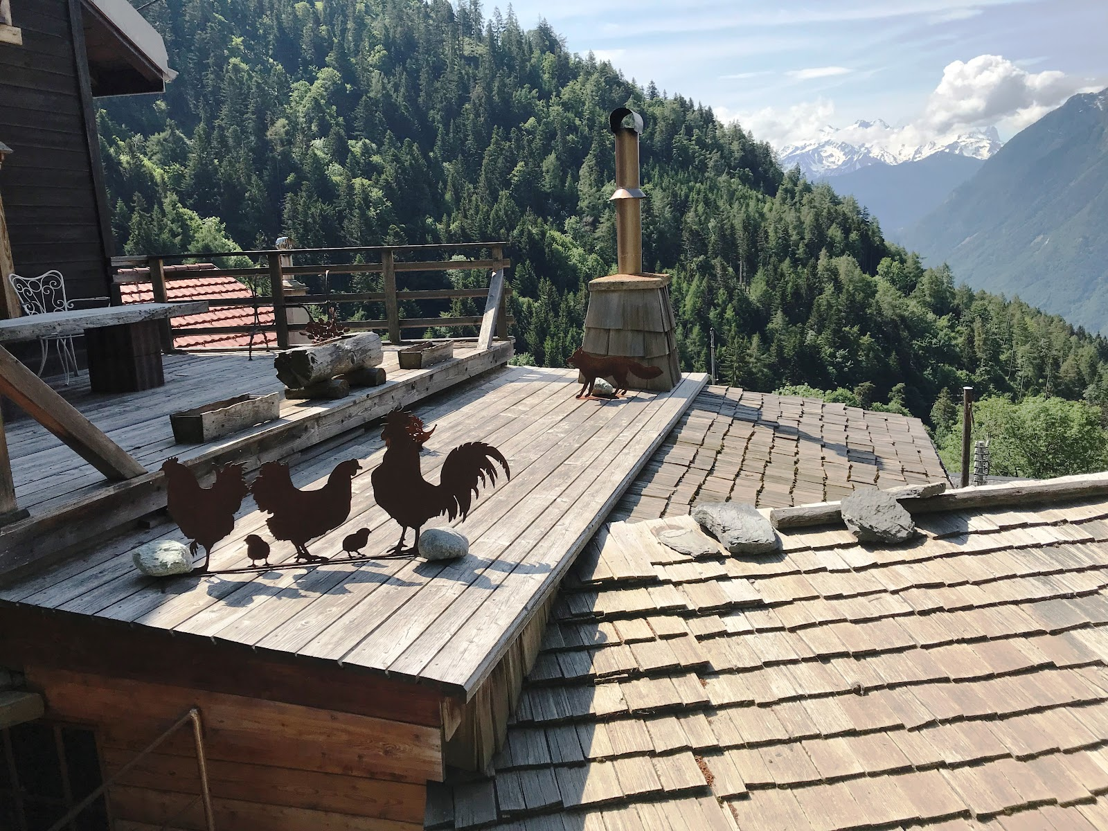 Climbing Rionda by bike - rooster weather vane on rooftop