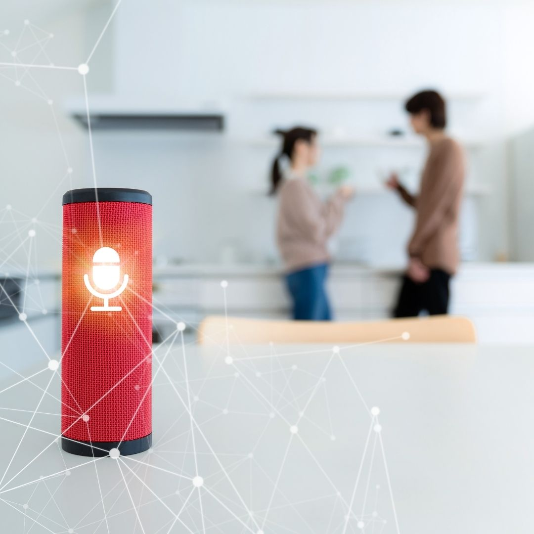 Photo of a smart speaker lighting up to listen to voice prompts.