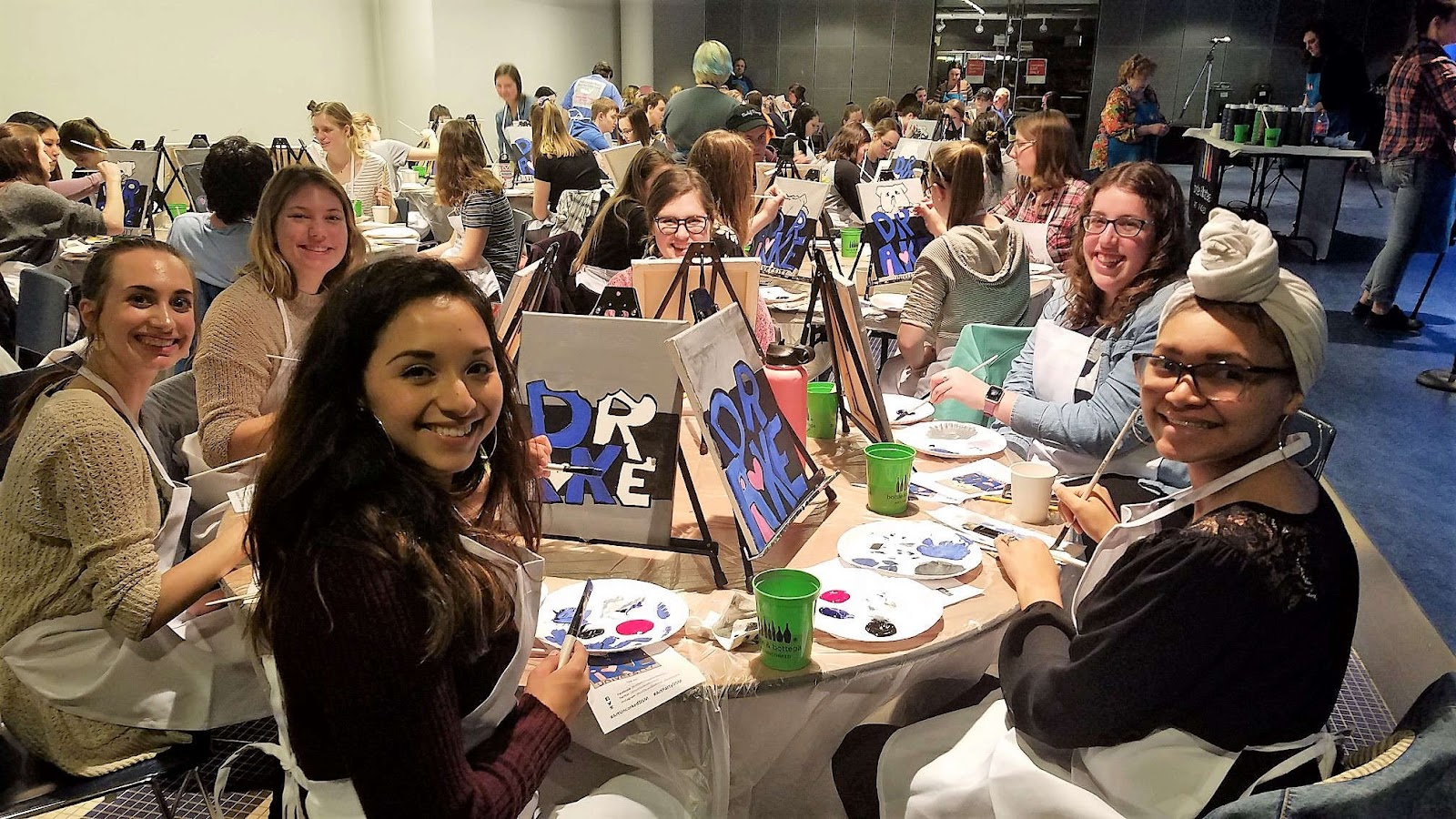 Drake University students painting mascot