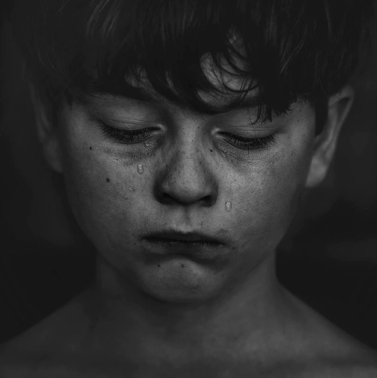 Image of a crying, bullied child.