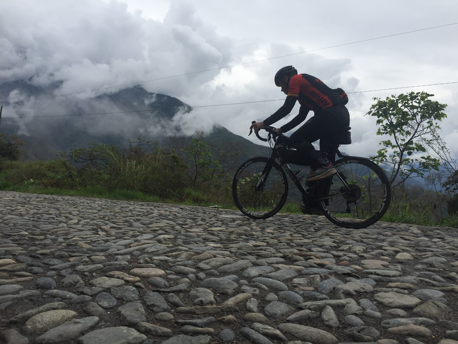 Cyclists riding on cobbles on North Yungas Road near Coroico, Bolivia