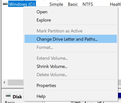 Right-click the hidden partition and choose Change Drive Letter and Path...
