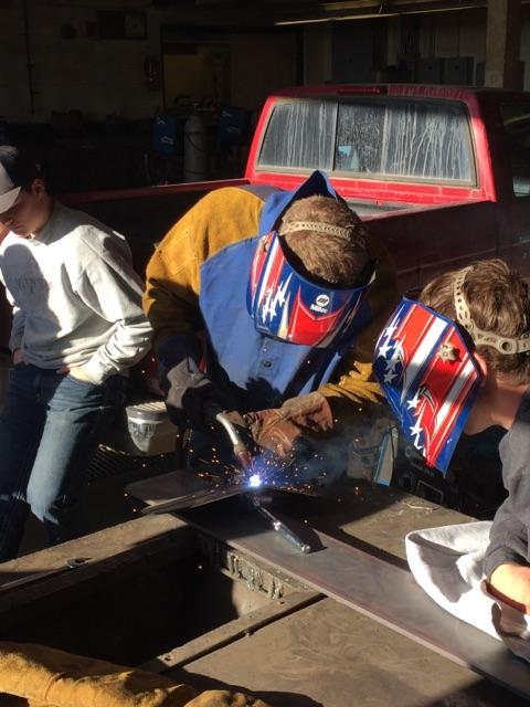Student Building a DIY Bumper Kit