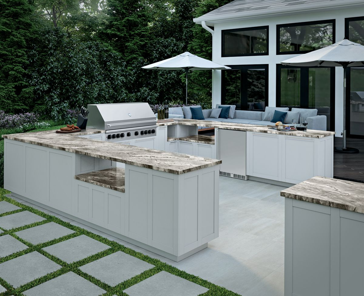 Outdoor kitchen with gauged porcelain tile panel/slab countertops