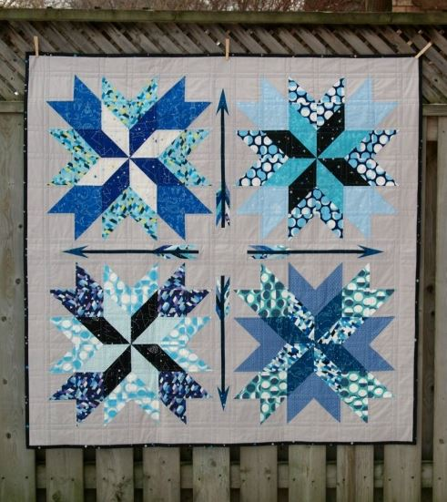 Quilt Featuring Blue Arrow Blocks