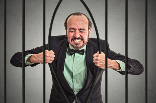 Image of a man bending bars - represents a schoolteacher who caught a break and is making a million dollars