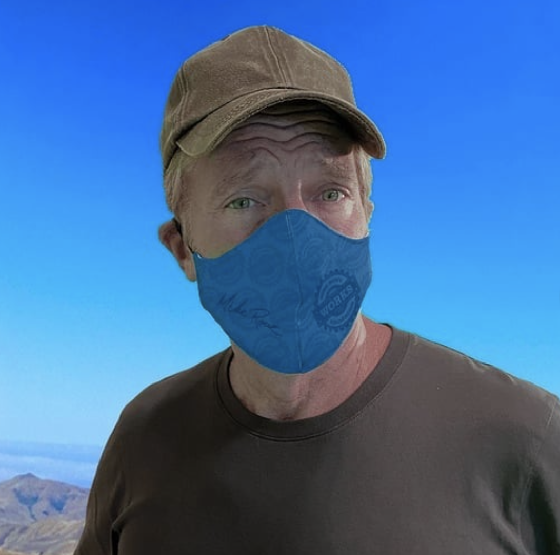Reality TV Star Mike Rowe wearing baseball cap and mask