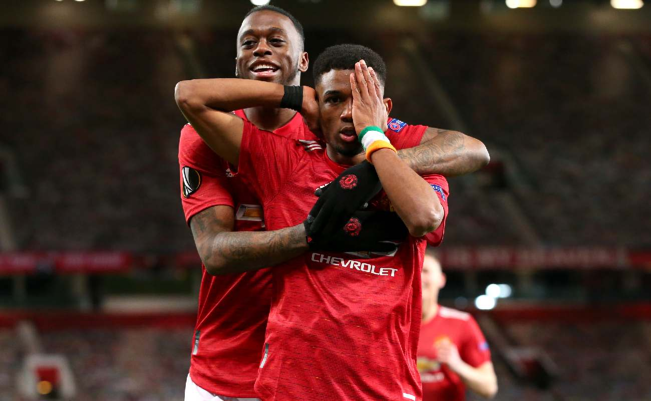Alt: Amad Diallo celebrates with Aaron Wan-Bissaka after scoring his first goal for Manchester United - Photo by Alex Livesey - Danehouse/Getty Images