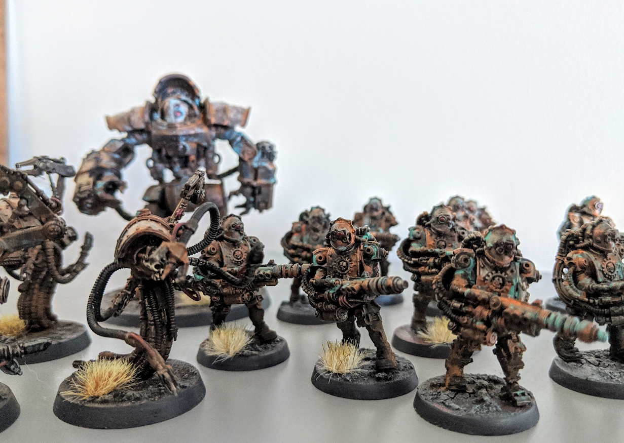 a collection of rust covered miniatures from the Horus Heresy range, Mechnaicum