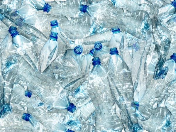 pile of empty recyclable plastic water bottles
