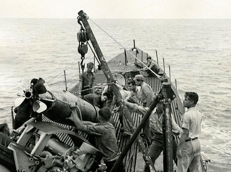 Bob (top left) helping crew of Besugo retrieve Japanese torpedo, circa 1946-'47