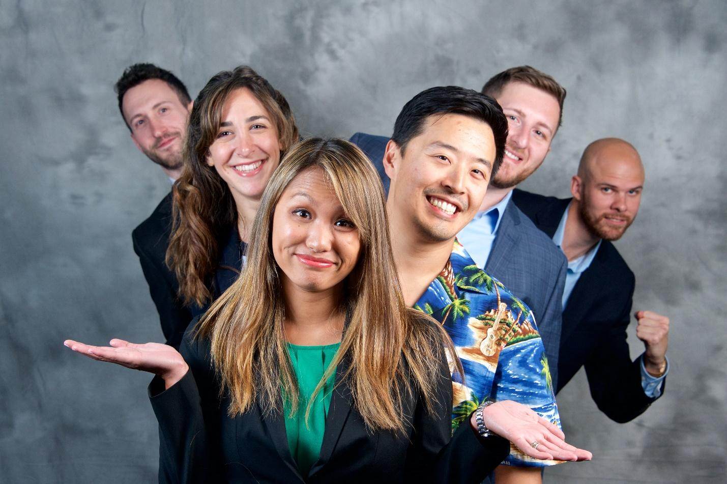 A group of people posing for the camera  Description automatically generated