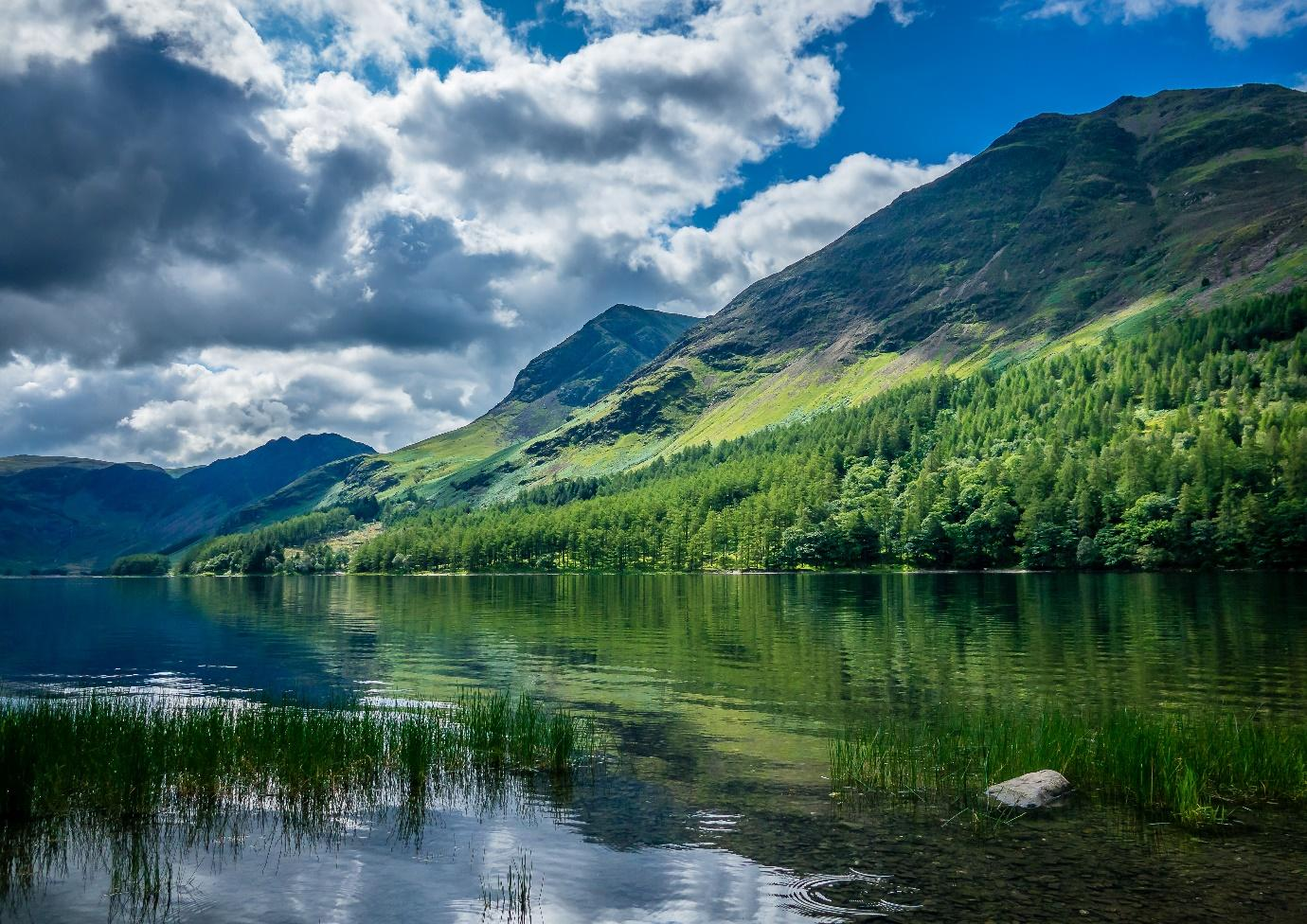 A picture containing water, nature, lake, mountain  Description automatically generated