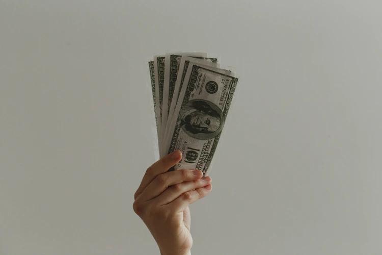 Woman holding money.