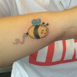 cartoon bee tattoo on arm