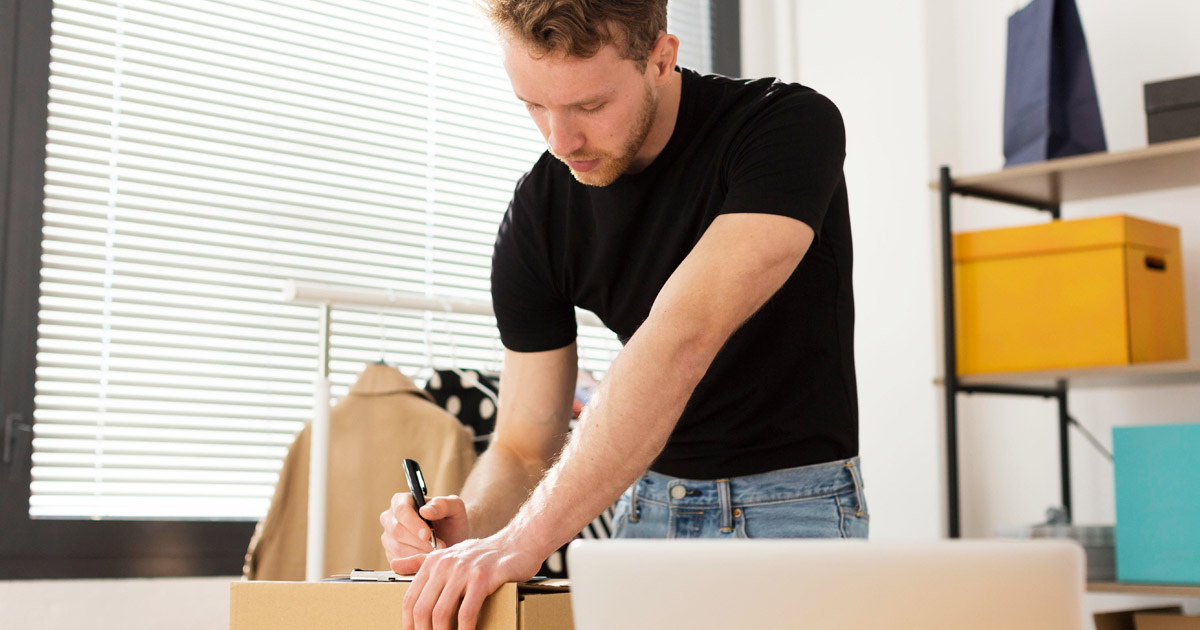man writing down inventroy
