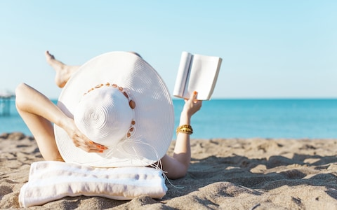 Image result for reading on the beach