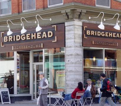 A group of people standing in front of Bridgehead Coffee House