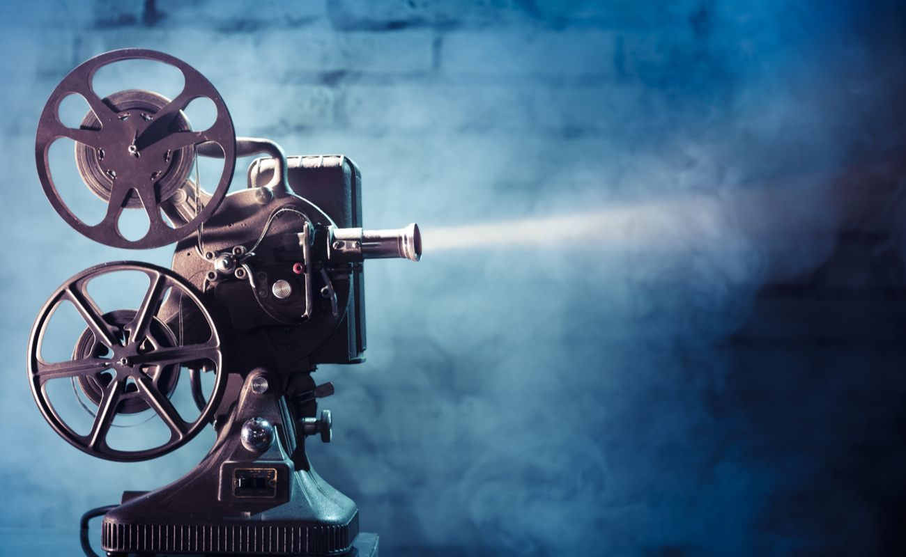 ALT: An old-fashioned film reel movie projector.