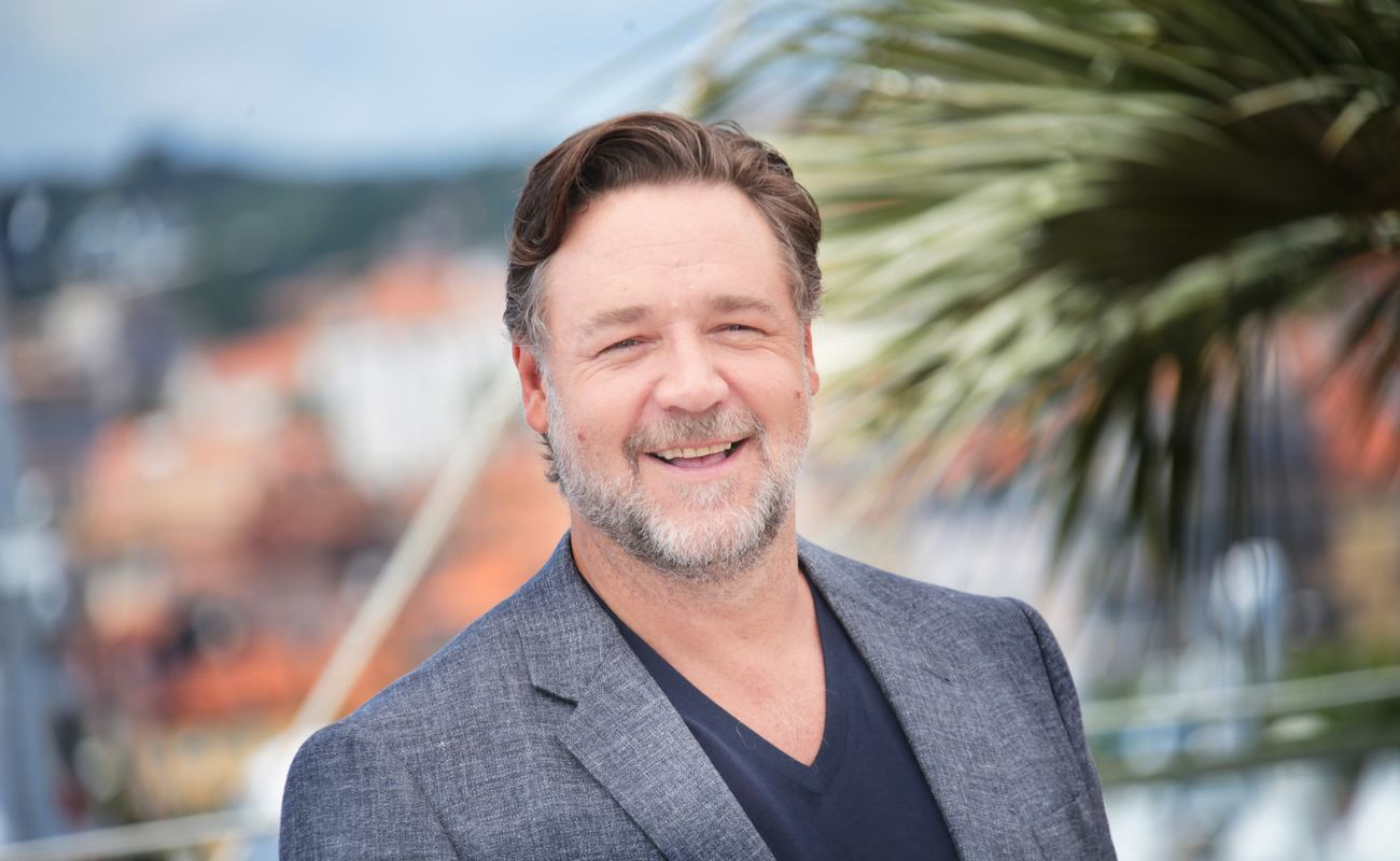 Russel Crowe smiling on a sunny day