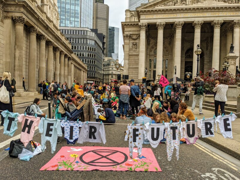 Hundreds of mothers blocked the road with their babies at XR Families' feed-in and play-in outside the Bank of England.