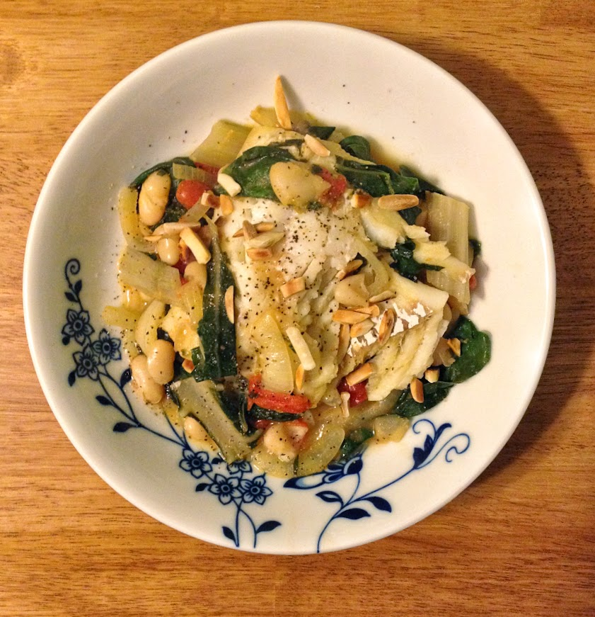 Plated Braised Cod with Swiss Chard, White Beans, and Almonds